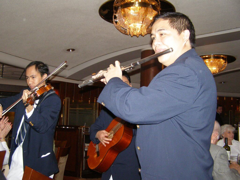 Musicians Serenade a Table of Diners