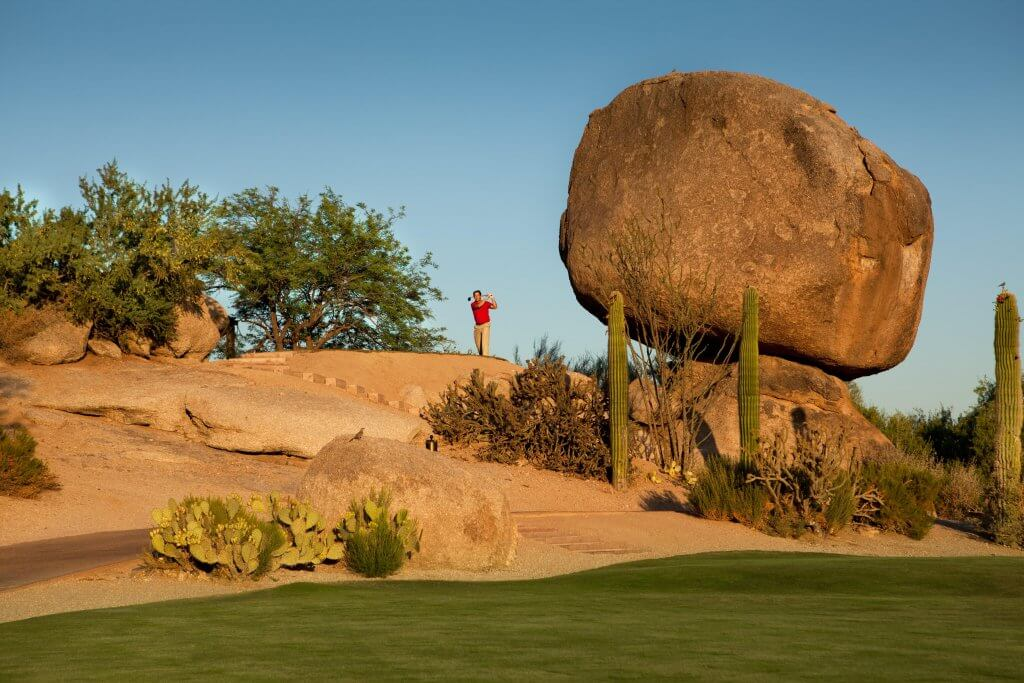 Golfing with a giant boulder in foreground