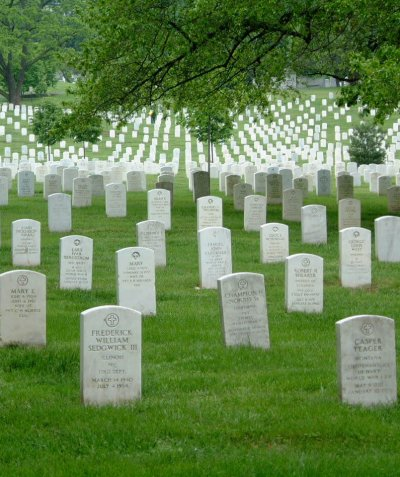 Rows of white headstoness honoring the fallen at Arlington