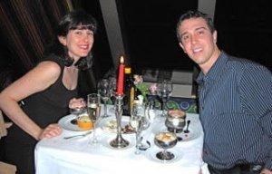 Couple has candlelight dinner on honeymoon cruise