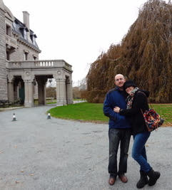 Couple in cold weather clothes standing together in front of Chanler Hotel where they spent their honeymoon