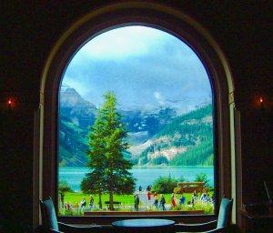 Great View from The Lakeview Lounge of mountains, lake, and trees.